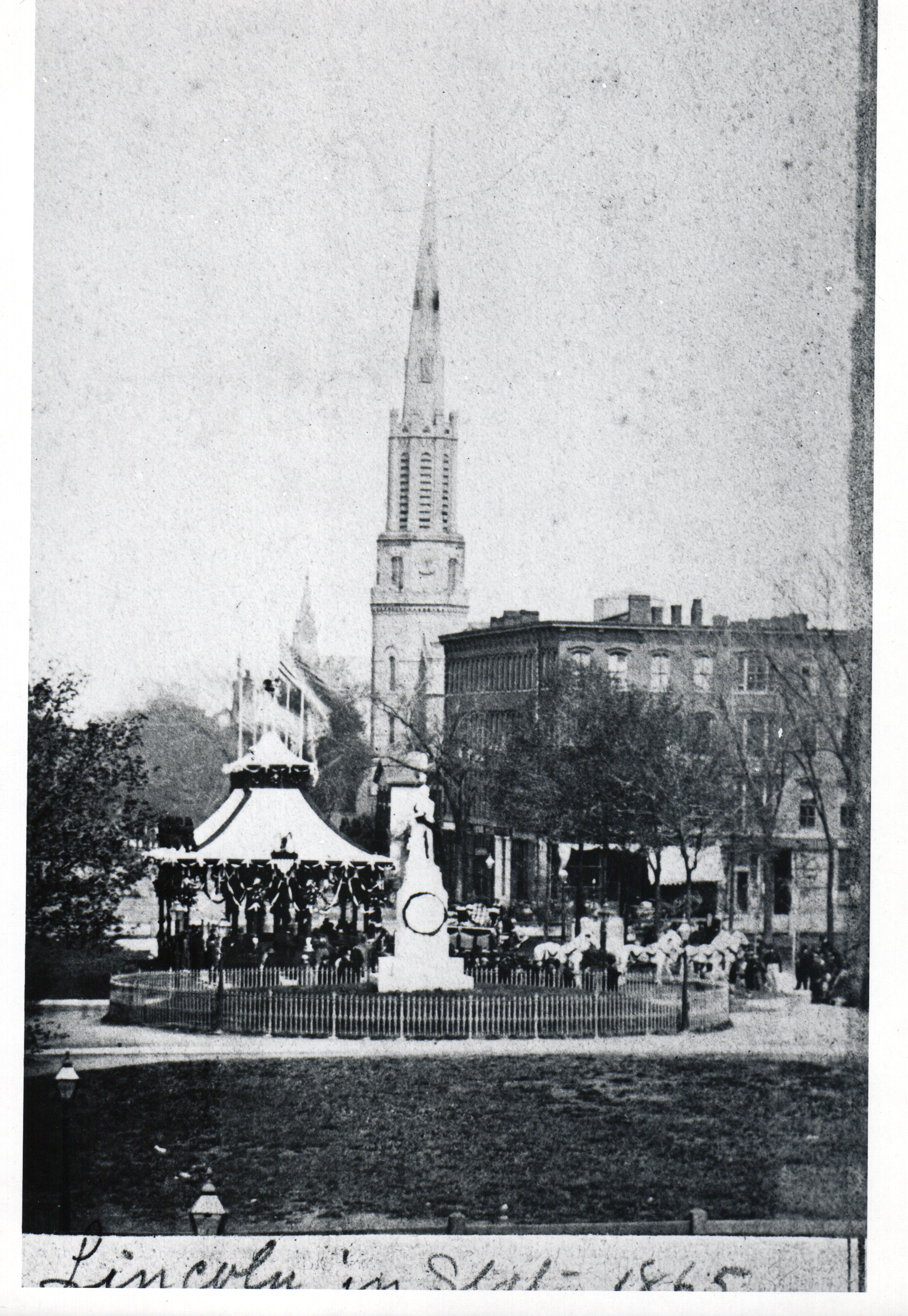 Lincoln's catafalque on Public Square, Cleveland, Ohio with monument statue of Oliver Hazard Perry in foreground April 28, 1865