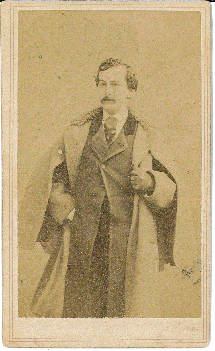 Card- Picture of John Wilkes Booth standing with coat (front)