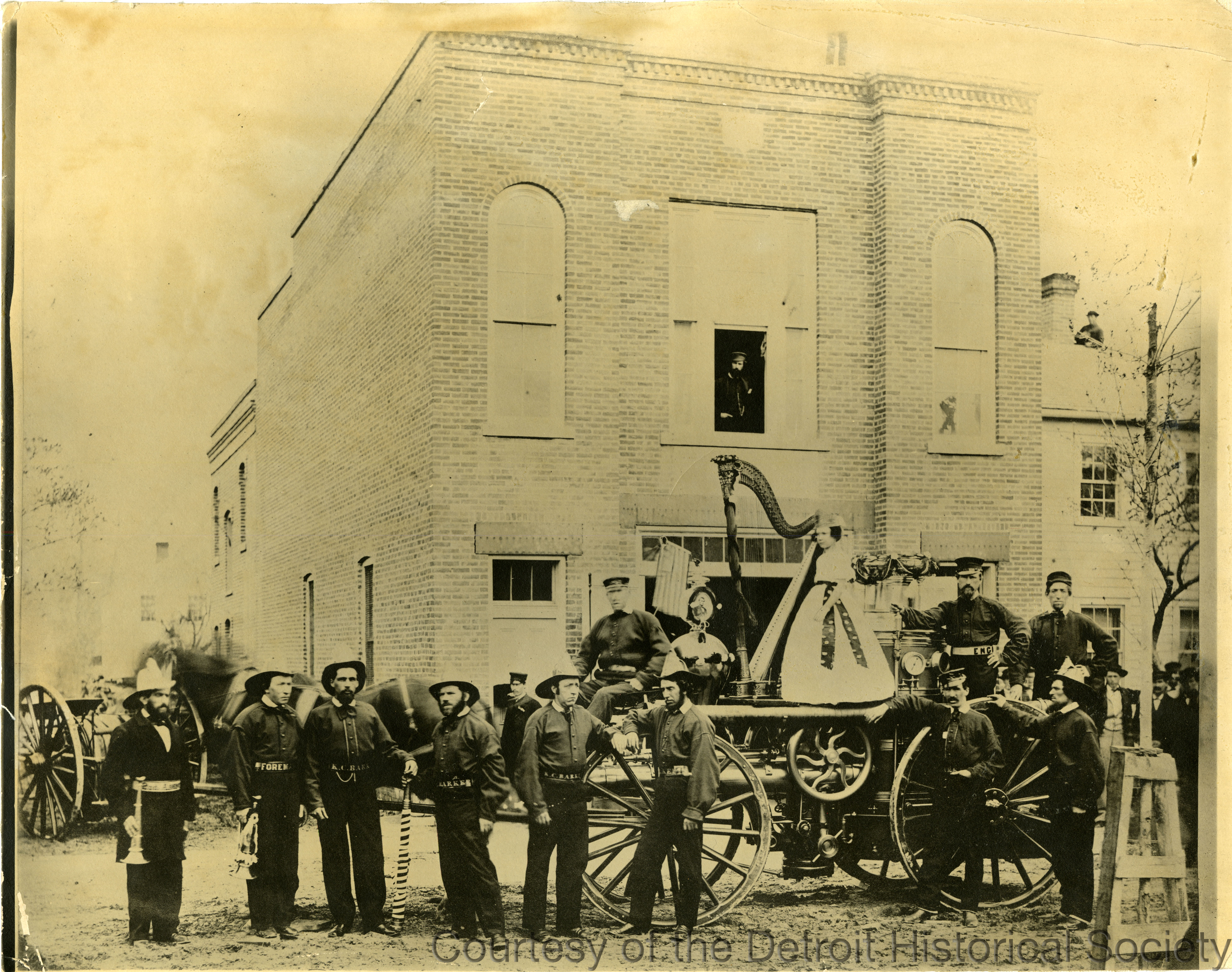 The firefighters of Detroit's K.C. Barker Company No. 4 posed with their engine decorated for a Lincoln memorial parade