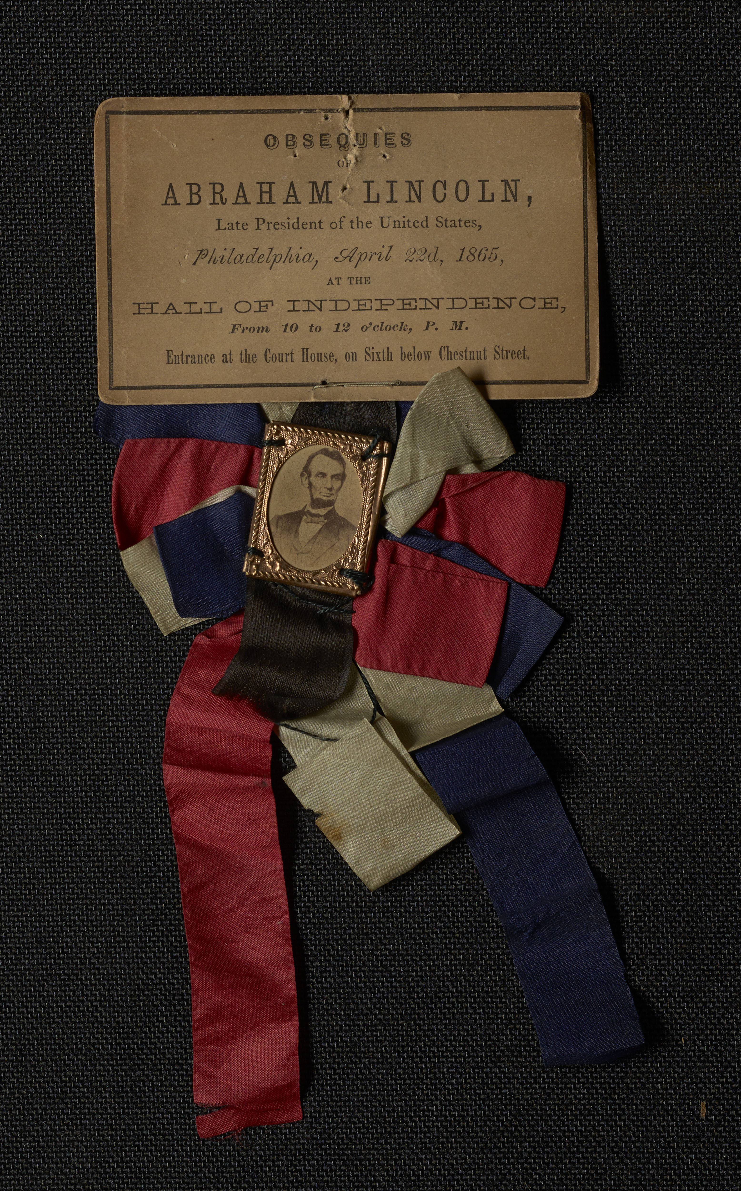 Mourning ribbon for services in honor of Lincoln in Philadelphia.